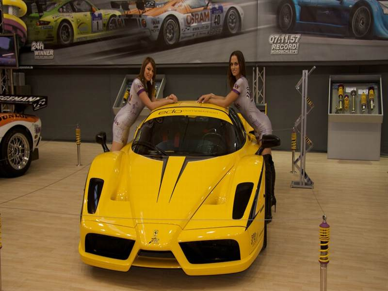 Ferrari with two model girls