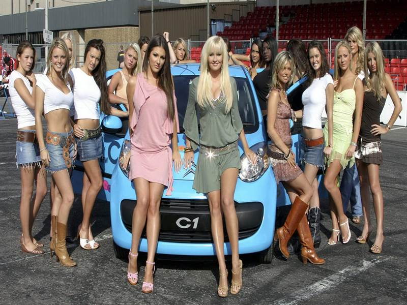 Beautiful girls with mini car photo